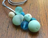 Bubble Bunch necklace in Aqua, Teal, Mint and cream resin beads | stratdesigns  A lush colour selection of beautiful, matt finish resin beads in an assortment of sizes and shapes all hand wired onto a  soft suede cord and finished with a magnetic clasp for effortless dressing.