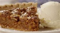This is a pecan pie with a fruity twist. Coconut and plump raisins are stirred into a sweet pecan pie filling and baked. Serve with vanilla ice cream or freshly whipped cream.