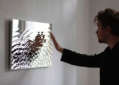 Using broken mirrors to project water on the wall.
