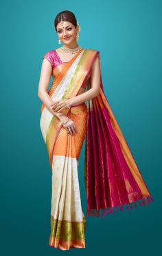 Kajal is seen in a beautiful multi coloured Saree paired with a choker neckpiece. www.shopzters.com