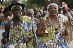 Voodoo worshipers dance at the Temple of Pythons during the annual Voodoo Festival in Ouidah, Benin.