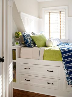 The petite bedroom features two skinny closets that flank the entry and four deep drawers below the bed. A bounty of baskets and boxes adds another layer of shipshape organization to this miniature marvel.