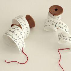Studio Carta: Rotolino Greetings -- greetings written on strip of paper and wound around spool