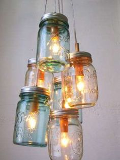 What would look better hanging over your farmhouse table than a cluster of Mason jar lights? Design*... - Courtesy Boots N Gus via Etsy