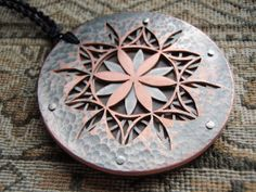 I love all the sacred geometry pendants in this Etsy shop!