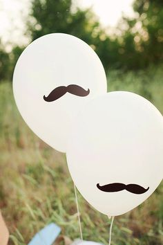 draw a mustache on a balloon with a black marker.