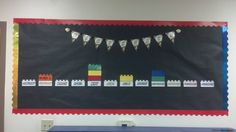 Lego classroom birthday bulletin board, themed decor.