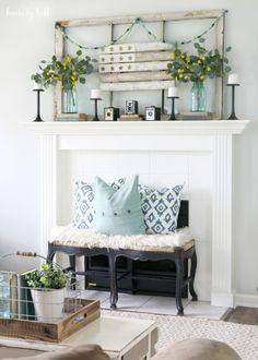 Mantel From the wood pallet flag to a collection of vintage cameras, this mantel is a flea market shopper's dream display.  See more at House by Hoff.