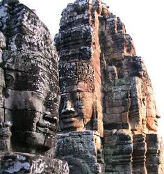 Giant faces of the Bayon  The Bayon is one of the strangest temples at Angkor. The towers of this Buddhist sanctuary are studded with numerous smiling and enigmatic faces, each around 2 meters high. They represent the bodhisattva Lokeshvara but carry the features of the temple's apparently egotistic builder, Jayavarman VII.