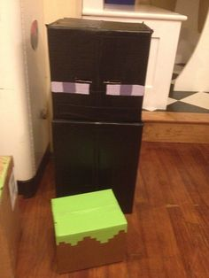 Enderman Costume w/ Grass Block  3 cardboard boxed, some duct tape and several $2.99 sample paints from Home Depot.