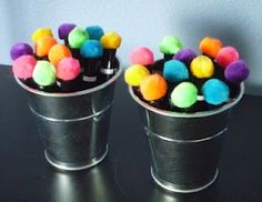 Pom Poms glued onto dry erase marker caps = instant erasers.  Genius!