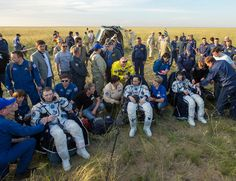 Expedition 43 commander Terry Virts of NASA, left, cosmonaut Anton Shkaplerov of the Russian Federal Space Agency (Roscosmos), center, and Italian astronaut Samantha Cristoforetti from European Space Agency (ESA) sit in chairs outside the Soyuz TMA-15M spacecraft just minutes after they landed in a remote area near the town of Zhezkazgan, Kazakhstan, on Thursday, June 11, 2015. Virtz, Shkaplerov, and Cristoforetti are returning after more than six months onboard the International Space…