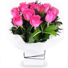Neon - hot pink roses displayed in a classic box.
