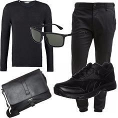 L'uomo in nero ha sempre un fascino e un velo misterioso...come sarà il suo sguardo dietro quei Ray-Ban scuri ? Sono i dettagli che fanno la differenza come la borsa a tracolla di PIER ONE , la maglia a righe abbinata a pantaloni chino con elastico alle caviglie e scarpa sportiva.