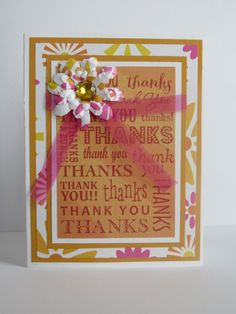 Handmade greeting card.  Bright pink and yellow thank you with coordinating paper flower.