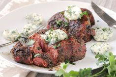 The sugar in the rub melts as the steaks cook and create a crunchy crust that is spicy sweet. The butter will mellow the peppery taste.