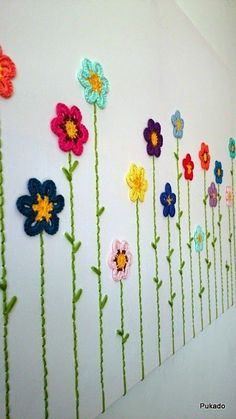 Crochet flowers with stems sewn onto canvas for DIY whimsical yarn artwork - free flower patterns and tutorial by Patricia Stuart: Crochainting Crochet Wall Art, Crochet Wall Hangings, Crochet Home Decor, Love Crochet, Crochet Crafts, Crochet Projects, Knit Crochet, Beautiful Crochet, Crochet Flower Patterns
