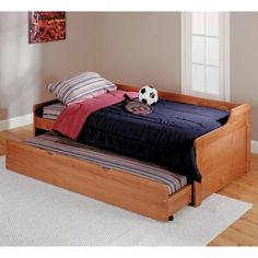 Perfect for a child's bedroom or guest room the Ethan Trundle Daybed is crafted of durable solid pine and features a warm medium wood finish that'll go with any color scheme. Gentle curves create an inviting frame around the main bed bringing a  relaxed and airy feel to any room. When you need an extra bed the  trundle slides out easily on side roller glides to accommodate an overnight  guest - or a younger sibling. Side rails and supportive slat