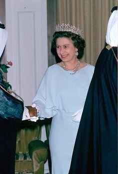 Queen Elizabeth II attending a banquet in Oman as part of a Gulf Tour
