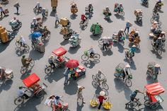 "Fragments of Hanoi - A birds eye view of the various forms of street traffic seen in the city centre of Hanoi, Vietnam.  This image is the result of various composite frames to form a final result.  <a href=""http://www.peterstewartphotography.com"">www.peterstewartphotography.com </a> <b> Follow my latest updates on: </b> <a href=""http://facebook.com/PeterStewartPhotography""> Facebook  