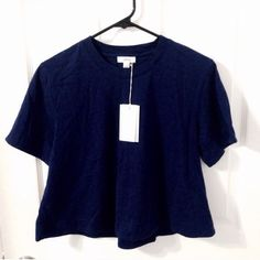 Aritzia Boxy Crop Top Brand new with tags. This top is perfect with high waisted jeans. Pair this with white shorts during the Summer and you've got your warm weather staple <3 Shipping is every Monday & Thursday. Aritzia Tops