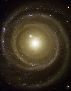To the surprise of astronomers, the galaxy, called NGC 4622, appears to be rotating in the opposite direction to what they expected. Pictures by NASA's Hubble Space Telescope helped astronomers determine that the galaxy may be spinning clockwise by showing which side of the galaxy is closer to Earth. A Hubble telescope photo of the oddball galaxy is this month's Hubble Heritage offering. The image shows NGC 4622 and its outer pair of winding arms full of new stars [shown in blue].
