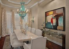 such a creamy fancy dining room, balanced nicely by the big abstract