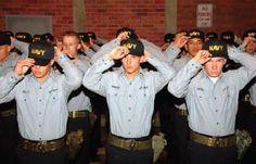 "Recruits finally earn their ""NAVY"" caps."