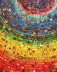 UK-based artist David T. Waller used 2,500 toy cars to create this colorful installation titled Car Atlas.