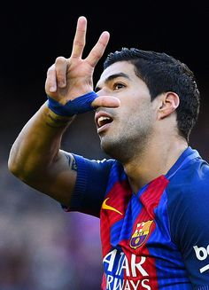 Luis Suarez of FC Barcelona celebrates after scoring his team's first goal during the La Liga match between FC Barcelona and UD Las Palmas at Camp Nou stadium on January 14, 2017 in Barcelona, Catalonia.