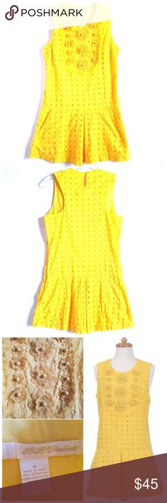 """BB Dakota Yellow Eyelet Drop Waist Dress So vibrant and beautiful! Dropped waist, a-line shape, front pockets, delicate bib of crocheted flowers. First two pics were taken by me and are of the actual dress. Color is most true in first two pics. Excellent, like, new condition! No rips, tears, stains. Size M. Approximate measurements: 32.5"""" length; 16.5"""" across dropped waist. No Trades! BB Dakota Dresses"""