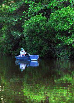 fisherman finds a deep, quiet spot on Kunkle Lake,  Ouabache State Park, Indiana