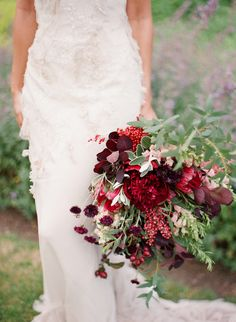Lush, loose bouquet of red blooms and foliage