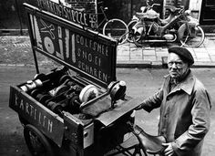 1960's. Scissors sharpener offers his services in the streets of Amsterdam. Photo Cor Jaring. #amsterdam #1960