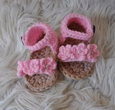 The perfect baby accessory for spring & summer! ~ These crochet sandals are handmade using a soft pink acrylic yarn and feature 3 small flowers accented with tiny pearls across the foot. They fasten at the sides with a wooden button making them easy to slip on/off. They can be made in just about any colour, so if you prefer something other than the pink shown, just send us a message. They are available in newborn, 3-6 months & 6-12 months sizes. Be sure to check out the rest of o...
