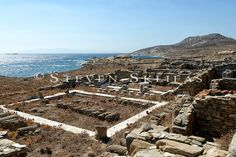 """View of peristyle house at the stadium quarter, Delos,Cyclades. It is thought that this building was a The Greek island of Delos was renowned for its perfumes, Pliny writes how """"in the old days, the most appreciated perfumes came from Delos"""" Delos Greece, Apollo And Artemis, The Old Days, Greek Islands, Grand Canyon, City Photo, Old Things, Buildings, Travel"""