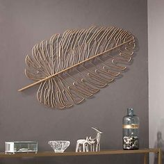 Feather your nest and quickly bring empty walls to life with the Aiden Lane Rahu Metal Feather Wall Sculpture. Metal wall sculpture blends into your curated décor collection or hangs alone as a statement piece.Our Gold Metal Feather Wall Plaque will Modern Wall Sculptures, Metal Wall Sculpture, Gold Walls, Metal Walls, Metal Art Decor, Modern Metal Wall Art, Contemporary Wall Decor, Feather Wall Art, Gold Wall Art