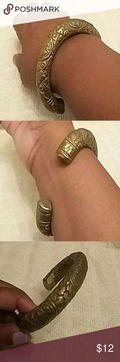 Vintage Asian theme brass bangle Embossed brass bangle depicts floral and Asian themes. Heavy brass with smooth interior. Some tarnish as depicted in photos. Great conversation piece. Fits small wrist! Jewelry Bracelets