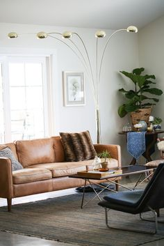 The next area to tackle of my Savers Home Makeover was the living room. It needed to be function, comfortable and stylishly-eclectic. My client already had a beautiful couch, coffee table and rug t. Interior Ideas, Interior Design, Person Sitting, The Help, Nest, Indoor, House Design, Couch, Homes