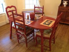 Hand painted red table and two ladderback chairs, $130 at Collectictuity in La Mesa. The other two chairs were purchased from Father Joe's Villages Thrift Store in La Mesa for $25 and painted to match by Collectiquity for $40.