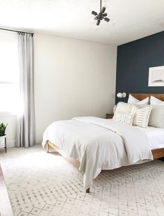 Neutral bedroom - lots of texture, love the dark accent wall!