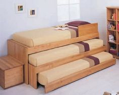 triple bunk bed, stores away neatly. - elegant decor