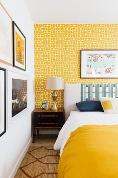 This beautiful bright yellow wallpaper transformed a guest room completely and the best part? It's removable wall paper! Click through for more info. Yellow Accent Walls, Yellow Accents, Living Room Decor, Bedroom Decor, Bedroom Ideas, Glam Bedroom, Stylish Bedroom, Guest Bedrooms, Retro Bedrooms