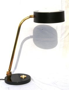 Charlotte Perriand; Painted Metal, Brass and Plastic Table Lamp for Jumo, 1940s.