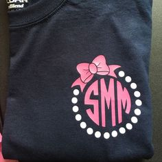 You can request our monograms in whatever colors you want ! Love this navy tee with the pink bow and pearl monogram ! Cricut Monogram, Monogram T Shirts, Monogram Decal, Vinyl Shirts, Monogram Design, Personalized T Shirts, Monogram Initials, Shirts For Girls, Kids Shirts