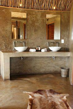 Raw. Minimal. Chic bathroom interior.