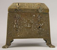 Casket with Figural Imagery Object Name: Casket Date: mid-13th century Geography: Iran Medium: Brass; worked metal sheet inlaid with silver Dimensions: H. 5 1/2 in. (14 cm) W. 5 1/2 in. (14 cm) Classification: Metal Credit Line: Edward C. Moore Collection, Bequest of Edward C. Moore, 1891 Accession Number: 91.1.564a, b