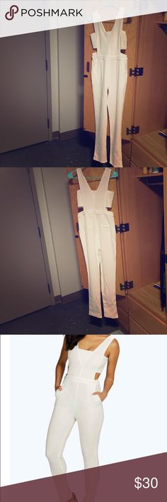 Side Strap Jumpsuit Never worn, white jumpsuit. It has cut outs on each side Other