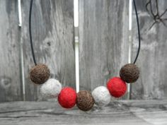 Sock Monkey toy inspired wool felt wet felted ball beaded necklace jewelry. $12.00, via Etsy.
