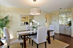 Transitional Dining Room with High ceiling, Built-in bookshelf, Hardwood floors, Carpet, Pendant light